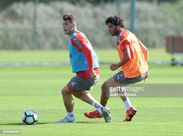Granit Xhaka and Mohamed Elneny of Arsenal during a training session at London Colney on September 23 2016 in St Albans England