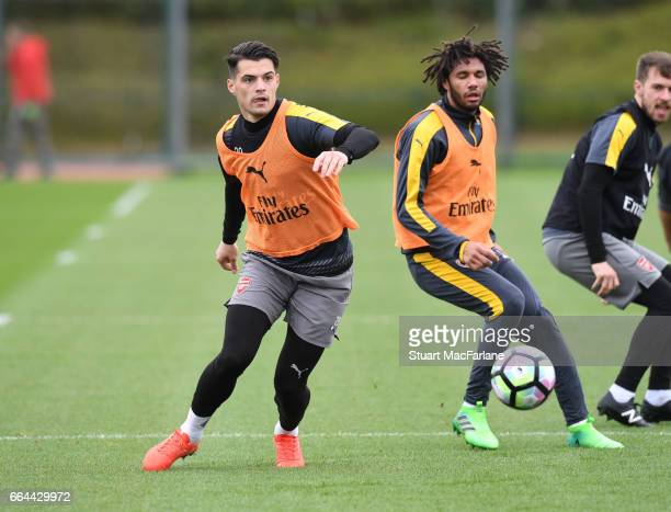 Granit Xhaka and Mohamed Elneny of Arsenal during a training session at London Colney on April 4 2017 in St Albans England