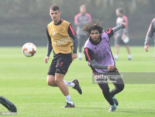 Granit Xhaka and Mohamed Elneny of Arsenal during a training session at London Colney on September 27 2017 in St Albans England