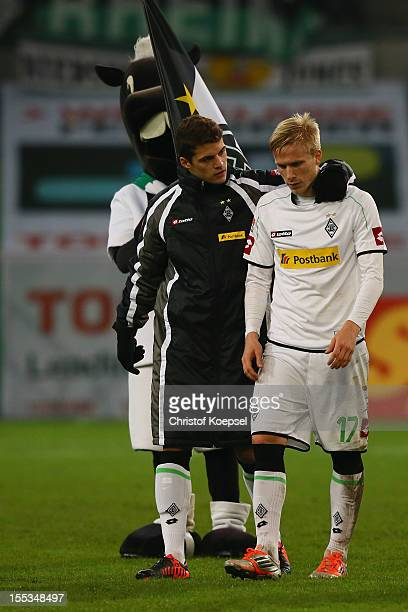 Granit Xhaka and Oscar Wendt of Moenchengladbach look dejected after the Bundesliga match between VfL Borussia Moenchengladbach and SC Freiburg at...