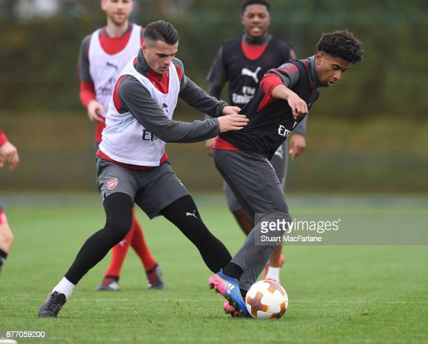 Granit Xhaka and Reiss Nelson of Arsenal during a training session at London Colney on November 21 2017 in St Albans England