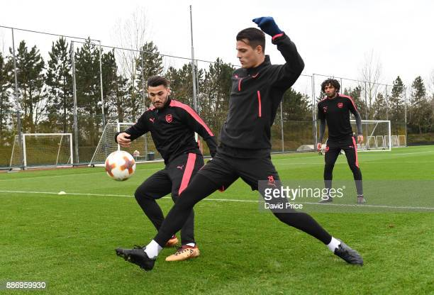 Granit Xhaka and Sead Kolasinac of Arsenal during an Arsenal Training Session at London Colney on December 6 2017 in St Albans England