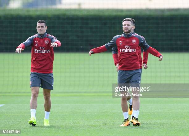 Granit Xhaka and Shkodran Mustafi of Arsenal during a training session at London Colney on August 10 2017 in St Albans England
