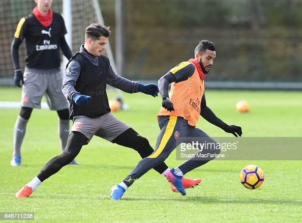 Granit Xhaka and Theo Walcott of Arsenal during a training session at London Colney on March 1 2017 in St Albans England