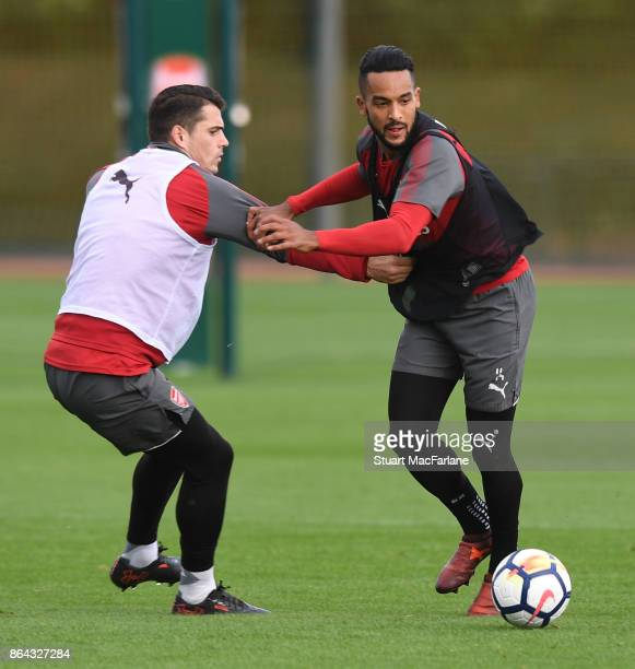 Granit Xhaka and Theo Walcott of Arsenal during a training session at London Colney on October 21 2017 in St Albans England