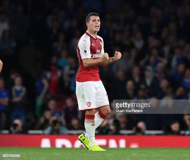 Granit Xhaka celebrates Arsenal victory after the Premier League match between Arsenal and Leicester City at Emirates Stadium on August 11 2017 in...