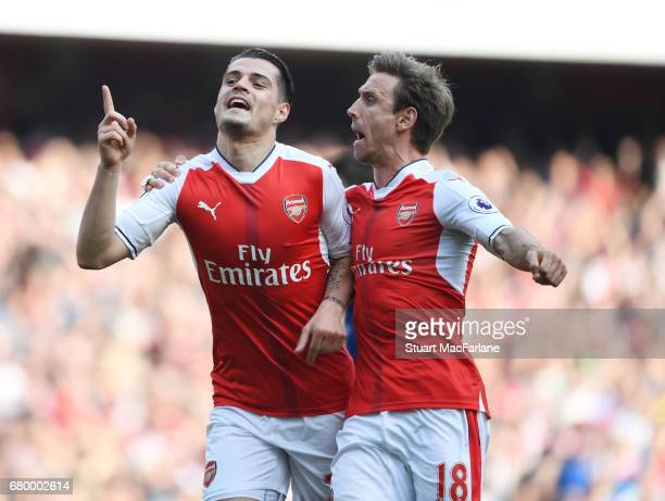 Granit Xhaka celebrates scoring the 1st Arsenal goal with Nacho Monreal during the Premier League match between Arsenal and Manchester United at...