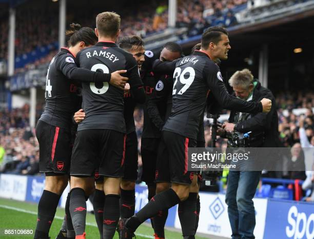 Granit Xhaka celebrates the 2nd Arsenal goal scored by Mesut Ozil during the Premier League match between Everton and Arsenal at Goodison Park on...