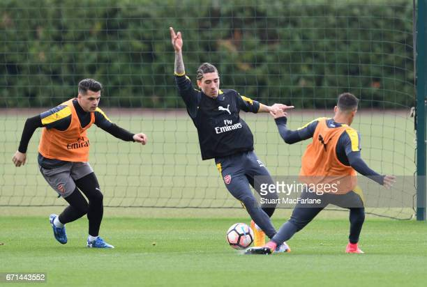 Granit Xhaka Hector Bellerin and Alexis Sanchez of Arsenal during a training session at London Colney on April 22 2017 in St Albans England