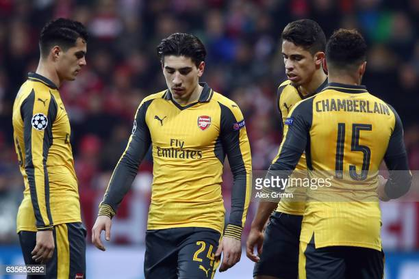 Granit Xhaka Hector Bellerin Gabriel Paulista and Alex OxladeChamberlain of Arsenal react during the UEFA Champions League Round of 16 first leg...