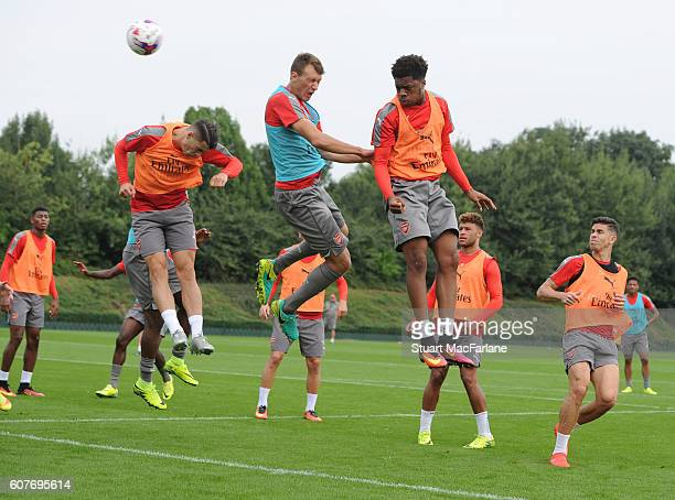 Granit Xhaka Krystian Bielik and Chuba Akpom of Arsenal during a training session at London Colney on September 19 2016 in St Albans England