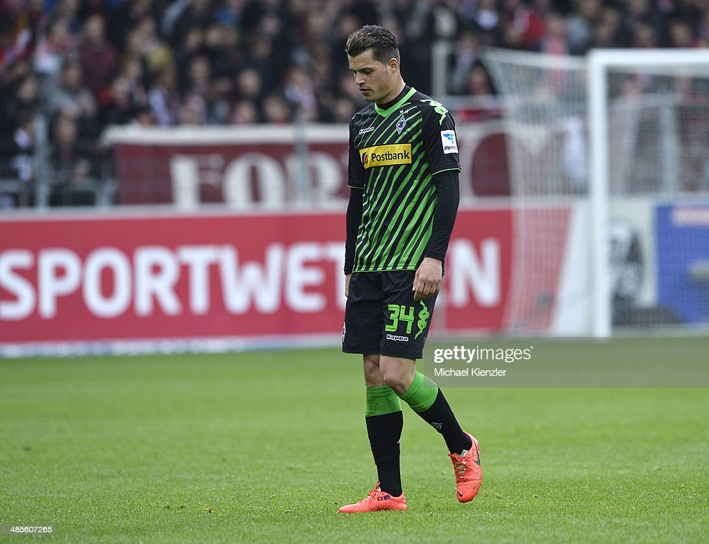 <a gi-track='captionPersonalityLinkClicked' href=/galleries/search?phrase=Granit+Xhaka&family=editorial&specificpeople=5848141 ng-click='$event.stopPropagation()'>Granit Xhaka</a> leaves pitch after red card during the Bundesliga match between SC Freiburg and Borussia Moenchengladbach at Mage Solar Stadium on April 19, 2014 in Freiburg, Germany.
