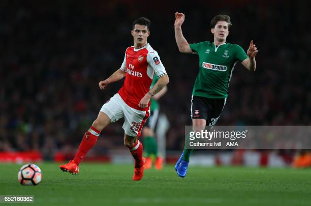 Granit Xhaka of Arsenal and Alex Woodyard of Lincoln City during The Emirates FA Cup QuarterFinal match between Arsenal and Lincoln City at Emirates...