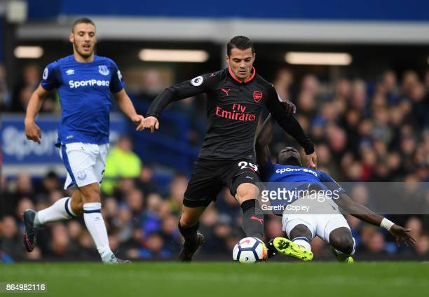 Granit Xhaka of Arsenal and Idrissa Gueye of Everton battle for possession during the Premier League match between Everton and Arsenal at Goodison...
