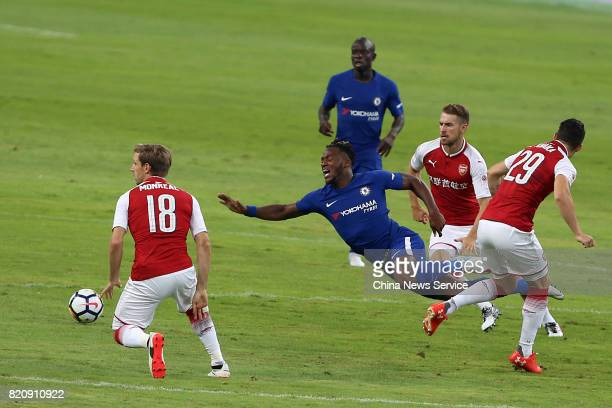 Granit Xhaka of Arsenal and Michy Batshuayi of Chelsea compete for the ball during a friendly match between Chelsea and Arsenal at Birds Nest on July...