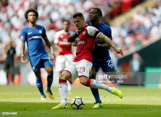 Granit Xhaka of Arsenal and Michy Batshuayi of Chelsea during the The FA Community Shield between Chelsea and Arsenal at Wembley Stadium on August 6...