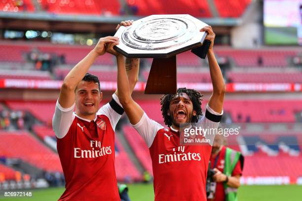 Granit Xhaka of Arsenal and Mohamed Elneny of Arsenal celebrate with the trophy following the The FA Community Shield final between Chelsea and...
