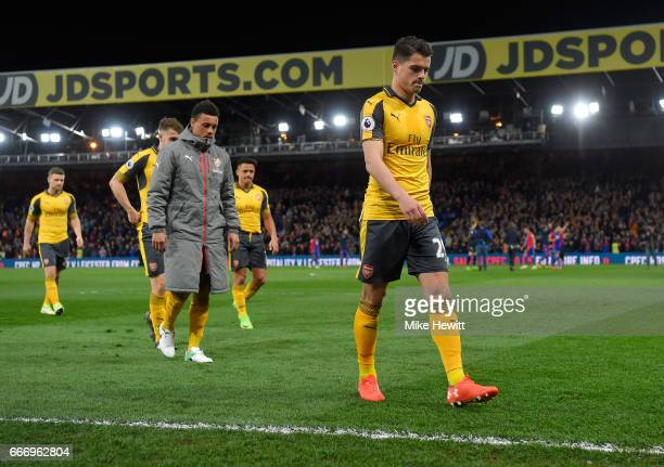Granit Xhaka of Arsenal and team mates look dejected in defeat after the Premier League match between Crystal Palace and Arsenal at Selhurst Park on...