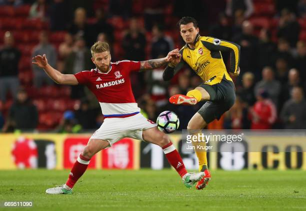 Granit Xhaka of Arsenal battles with Adam Clayton of Middlesbrough during the Premier League match between Middlesbrough and Arsenal at Riverside...