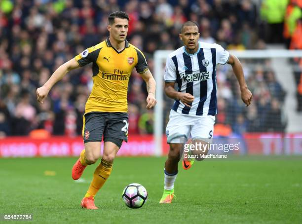 Granit Xhaka of Arsenal breaks past Salomon Rondon of West Brom during the Premier League match between West Bromwich Albion and Arsenal at The...