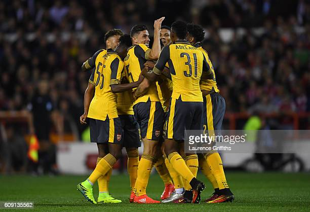 Granit Xhaka of Arsenal celebrates scoring the opening goal with team mates during the EFL Cup Third Round match between Nottingham Forest and...