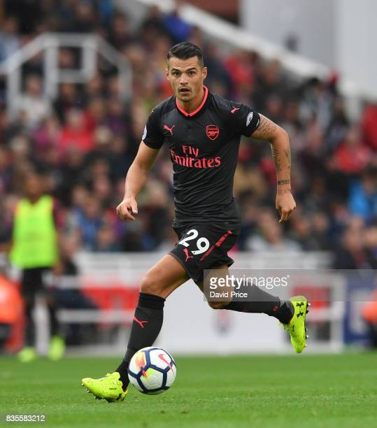 Granit Xhaka of Arsenal during the Premier League match between Stoke City and Arsenal at Bet365 Stadium on August 19 2017 in Stoke on Trent England