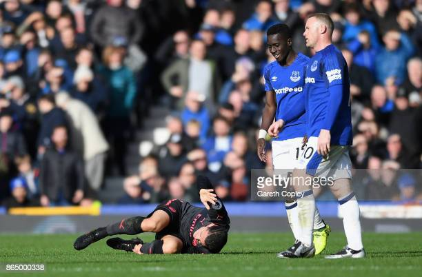 Granit Xhaka of Arsenal goes down injured during the Premier League match between Everton and Arsenal at Goodison Park on October 22 2017 in...