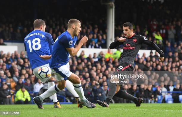 Granit Xhaka of Arsenal has his shot closed down by Gylfi Sigurdsson and Nikola Vlasic of Everton during the Premier League match between Everton and...