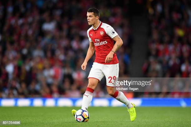 Granit Xhaka of Arsenal in action during the Premier League match between Arsenal and Leicester City at Emirates Stadium on August 11 2017 in London...