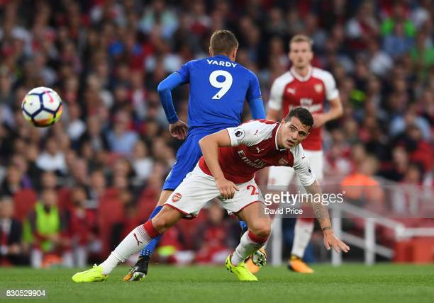 Granit Xhaka of Arsenal is challenged by Jamie Vardy of Leicester during the Premier League match between Arsenal and Leicester City at Emirates...