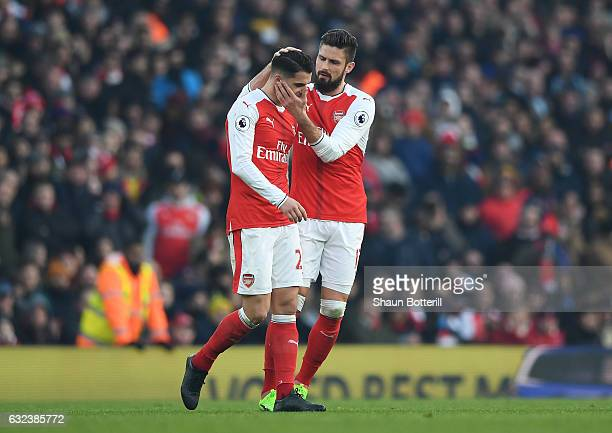 Granit Xhaka of Arsenal is consoled by his team mate Olivier Giroud after being shown a red card during the Premier League match between Arsenal and...