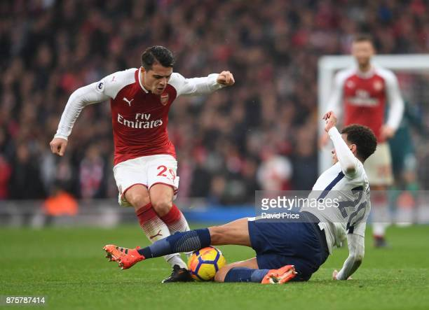 Granit Xhaka of Arsenal is tackled by Dele Alli of Tottenham during the Premier League match between Arsenal and Tottenham Hotspur at Emirates...