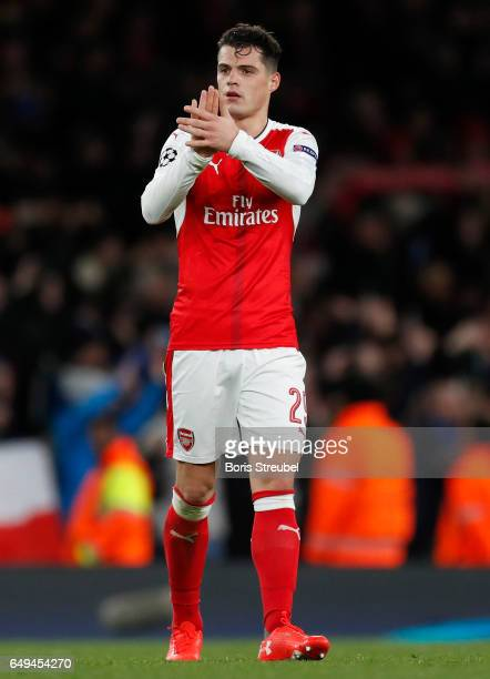 Granit Xhaka of Arsenal leaves the pitch after losing the UEFA Champions League Round of 16 second leg match between Arsenal FC and FC Bayern...