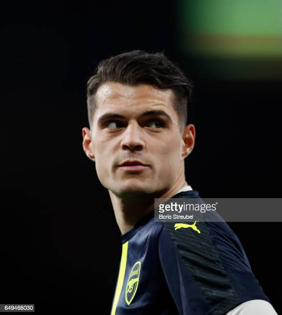 Granit Xhaka of Arsenal looks on prior to the UEFA Champions League Round of 16 second leg match between Arsenal FC and FC Bayern Muenchen at...