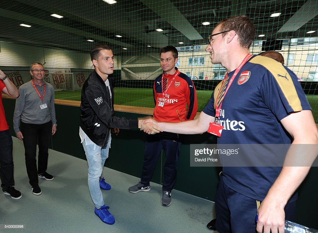 <a gi-track='captionPersonalityLinkClicked' href=/galleries/search?phrase=Granit+Xhaka&family=editorial&specificpeople=5848141 ng-click='$event.stopPropagation()'>Granit Xhaka</a> of Arsenal meets members of the Arsenal staff during his tour of Emirates Stadium on June 27, 2016 in London, England.