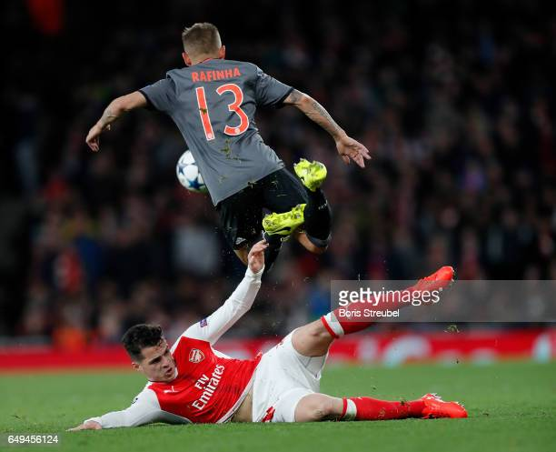 Granit Xhaka of Arsenal tackles Rafinha of FC Bayern Muenchen during the UEFA Champions League Round of 16 second leg match between Arsenal FC and FC...