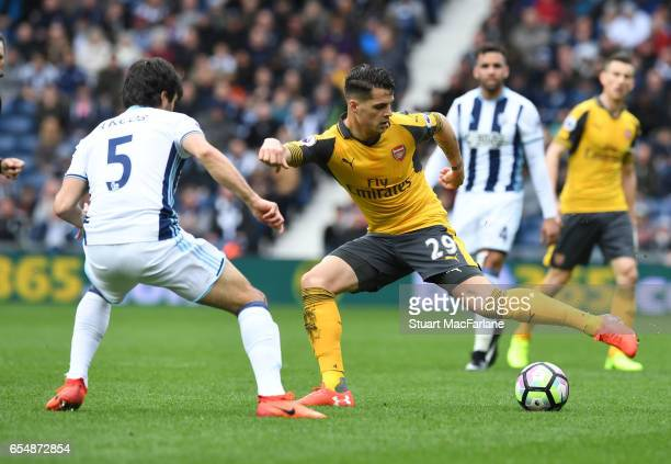 Granit Xhaka of Arsenal takes on Claudio Yacob of West Brom during the Premier League match between West Bromwich Albion and Arsenal at The Hawthorns...