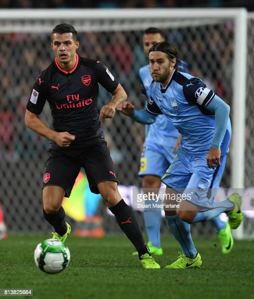 Granit Xhaka of Arsenal takes on Michael Zullo of Sydney FC during the preseason friendly match between Sydney FC and Arsenal at ANZ Stadium on July...