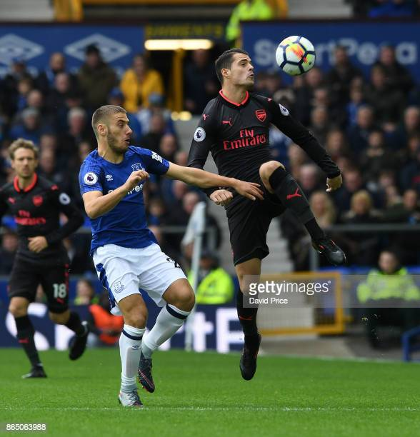 Granit Xhaka of Arsenal under pressure from Nikola Vlasic of Everton during the Premier League match between Everton and Arsenal at Goodison Park on...