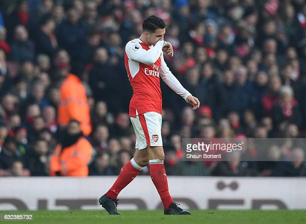 Granit Xhaka of Arsenal walks off the pitch after being shown a red card during the Premier League match between Arsenal and Burnley at the Emirates...