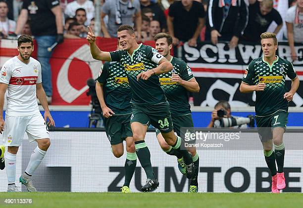 Granit Xhaka of Borussia Moenchengladbach celebrates his team's first goal with team mates during the Bundesliga match between VfB Stuttgart and...