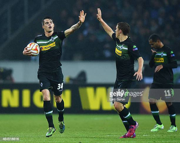 Granit Xhaka of Borussia Moenchengladbach celebrates with Max Kruse as he scores their first and equalising goal during the UEFA Europa League Round...