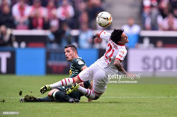Granit Xhaka of Borussia Moenchengladbach challenges Leonardo Bittencourt of 1 FC Koeln during the Bundesliga match between 1 FC Koeln and Borussia...