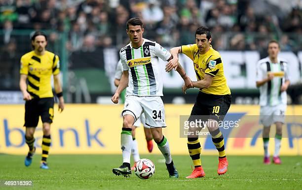Granit Xhaka of Borussia Moenchengladbach is challenged by Henrikh Mkhitaryan of Borussia Dortmund during the Bundesliga match again Borussia...