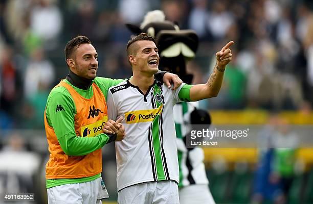Granit Xhaka of Moenchengladbach celebrates with team mate Josip Drmic after winning the Bundesliga match between Borussia Moenchengladbach and VfL...