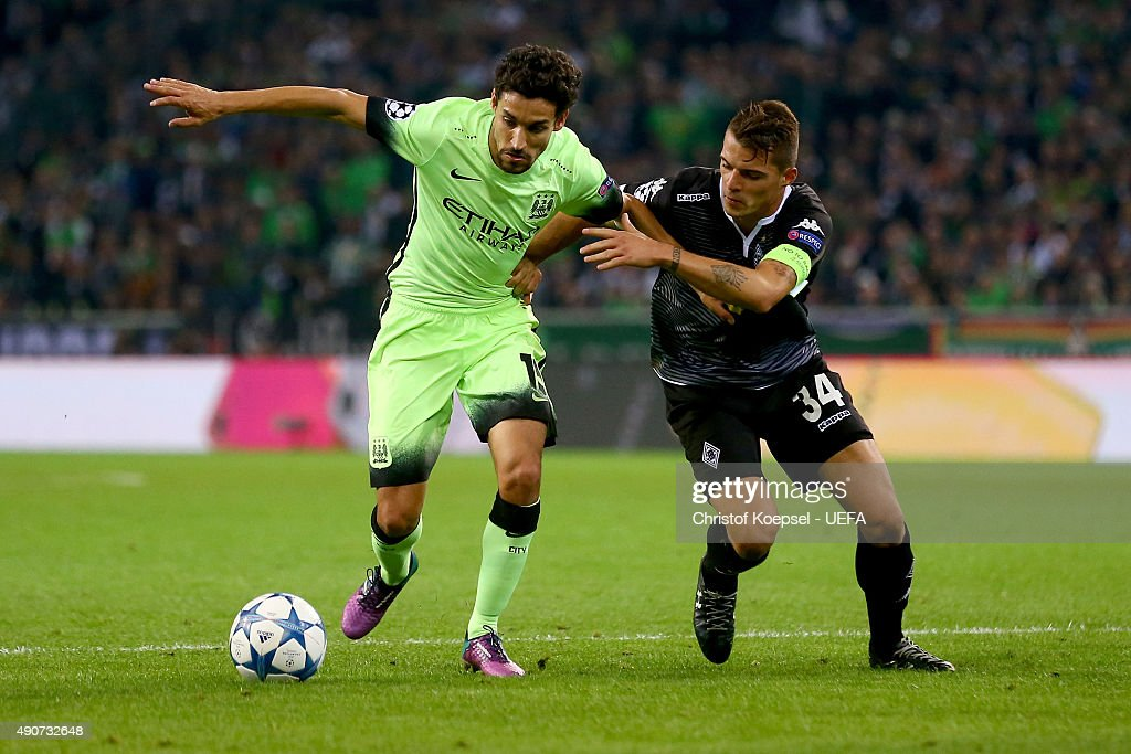 Granit Xhaka of Moenchengladbach0 (R) challenges Jesus Navas of Manchester City (L) during the UEFA Champions League Group D match between VfL Borussia Monchengladbach and Manchester City FC on September 30, 2015 in Moenchengladbach, Germany.