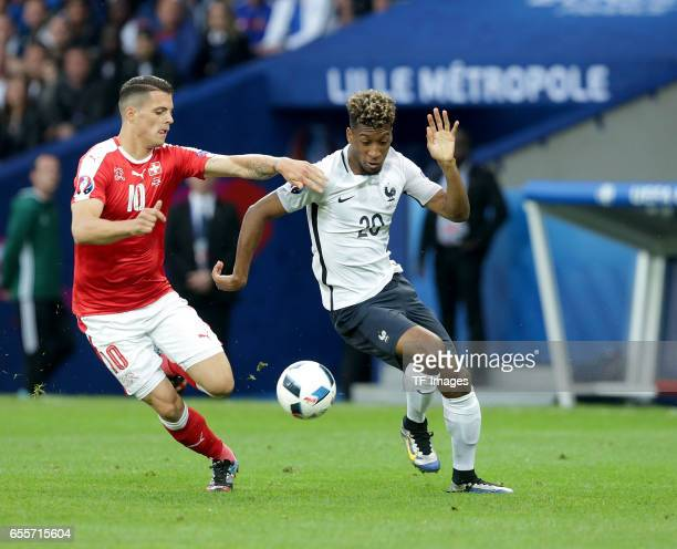 Granit Xhaka of Switzerland and Kingsley Coman of France battle for the ball during the UEFA Euro 2016 Group A match between the Switzerland and...