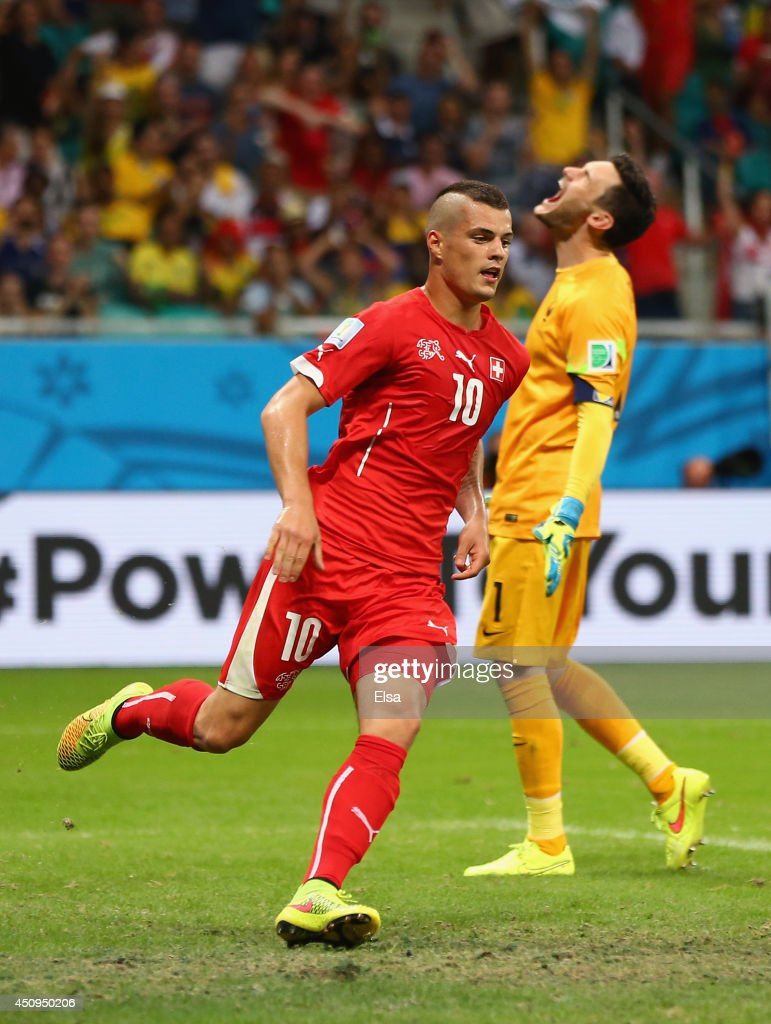 Granit Xhaka of Switzerland celebrates scoring his team's second goal as Hugo Lloris of France reacts during the 2014 FIFA World Cup Brazil Group E match between Switzerland and France at Arena Fonte Nova on June 20, 2014 in Salvador, Brazil.