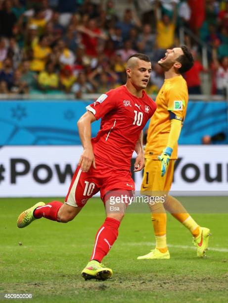 Granit Xhaka of Switzerland celebrates scoring his team's second goal as Hugo Lloris of France reacts during the 2014 FIFA World Cup Brazil Group E...