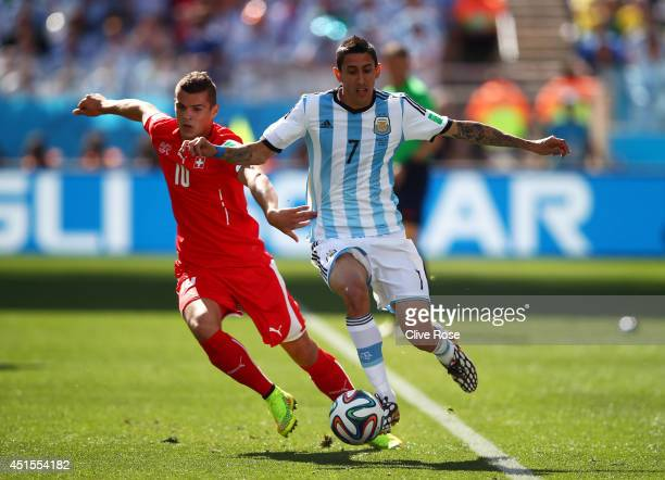 Granit Xhaka of Switzerland challenges Angel di Maria of Argentina during the 2014 FIFA World Cup Brazil Round of 16 match between Argentina and...